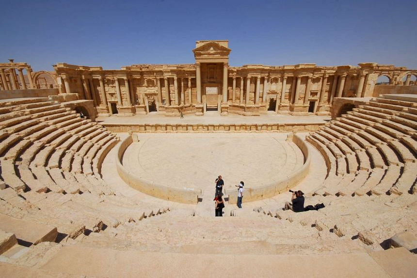 Tourists take pictures at the ancient Palmyra theatre in the historical city of Palmyra, Syria in a 2008 file photo.