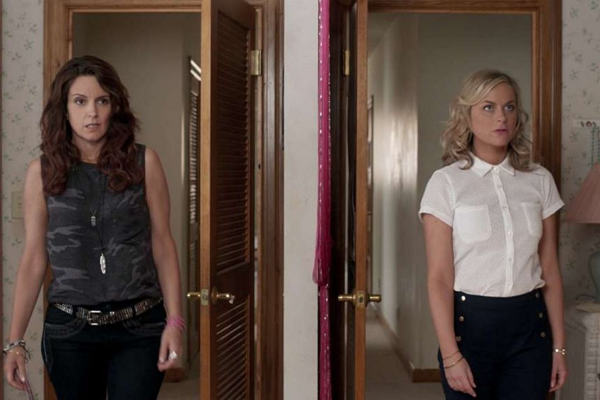 Tina Fey (left) and Amy Poehler star in the comedy Sisters, about two siblings who throw one last party in their childhood home.