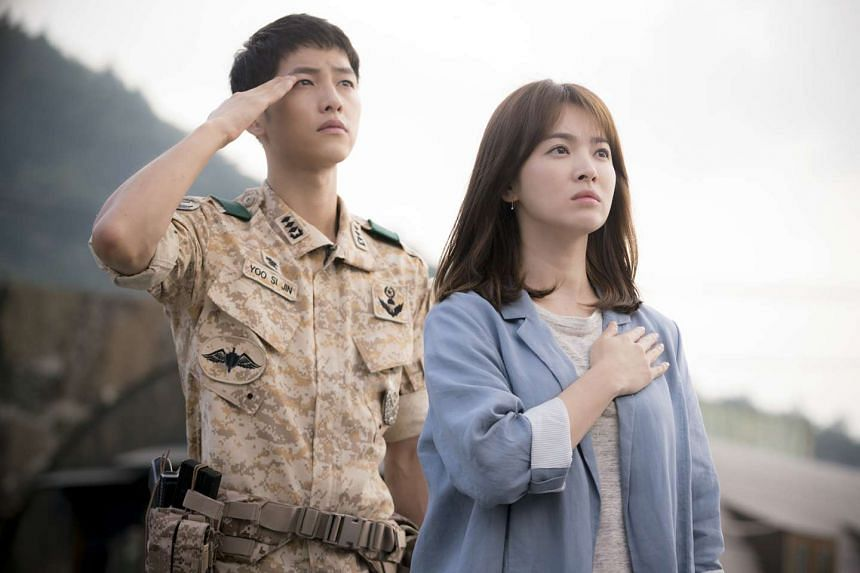 Song Joong Ki plays a soldier who falls for a surgeon, portrayed by Song Hye Kyo (both above) in Descendants Of The Sun.