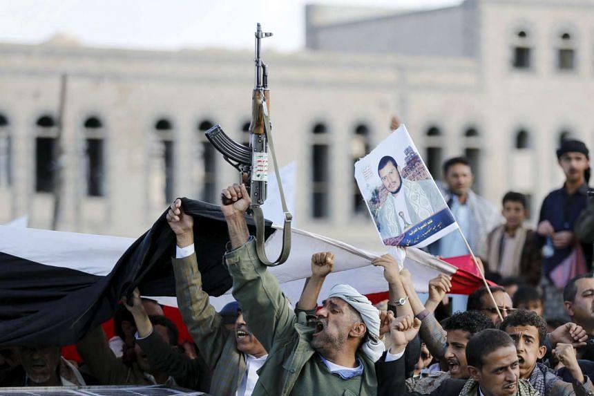 Houthi supporters demonstrating against Saudi Arabia-led air strikes in the Yemeni capital of Sanaa.