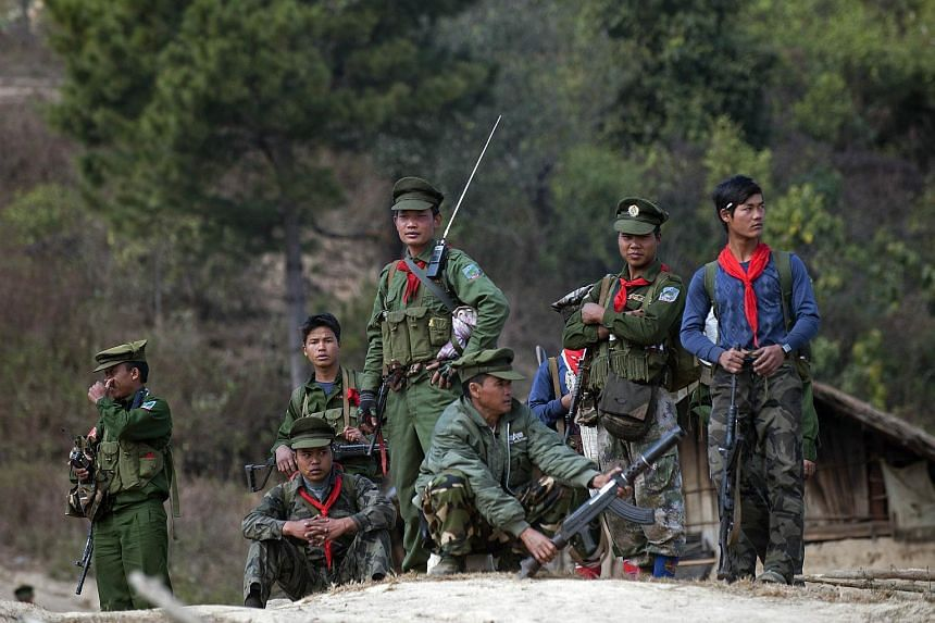 Taaung National Liberation Army, a Palaung ethnic armed group, standing guard outside a village in Mantong township, Myanmar on Jan 16, 2014.