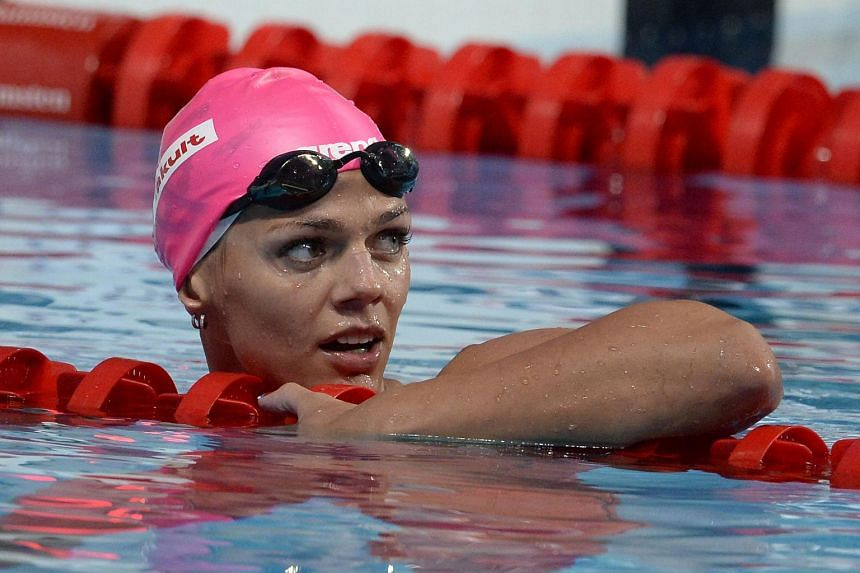 Russia's Yuliya Efimova looking at the time board after winning the women's 100m breaststroke event at the 2015 Fina World Championships in Kazan.