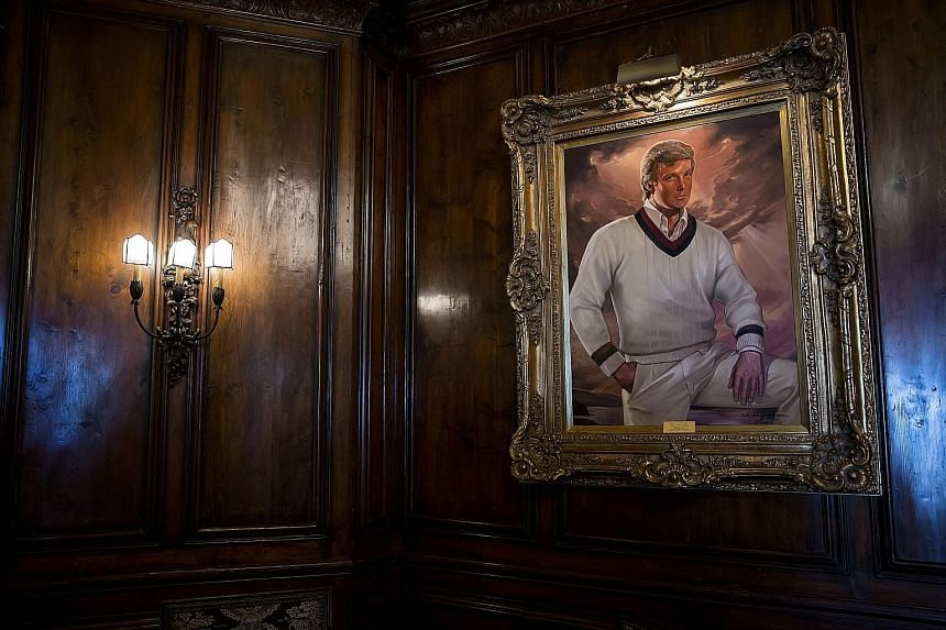 From far left: Mr Donald Trump's long-time butler Anthony Senecal, the Mar-a-Lago estate and the card room. Below: a portrait of Mr Trump in the bar. The living room of Mr Donald Trump's Mar-a-Lago estate.