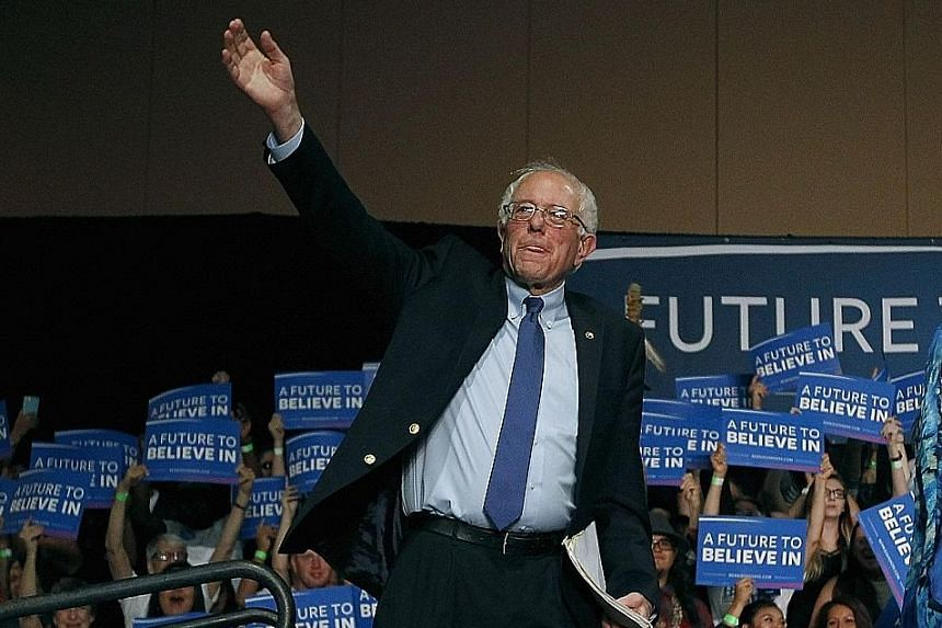 Mr Sanders in Phoenix, where his speech was apparently ignored by many cable networks as they focused on Mrs Clinton. Mrs Clinton holding a rally after winning the Florida primary on Tuesday. Her strong wins in Florida and North Carolina complete a c