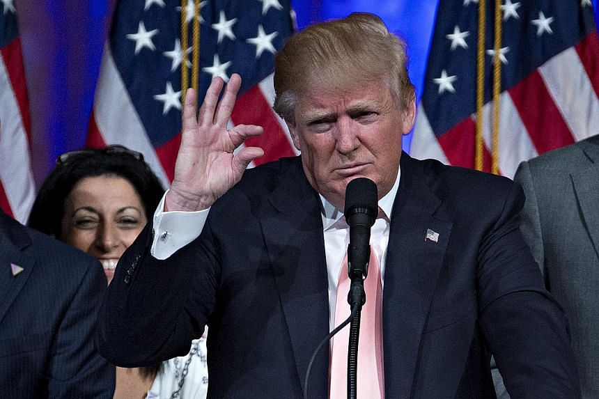 Mr Trump at a news conference in Florida after winning the state on Super Tuesday II. His strong performance has seen the Republican Party inching closer to chaos and considering a brokered convention in July. Trump supporter Rosemary Harder in Flori