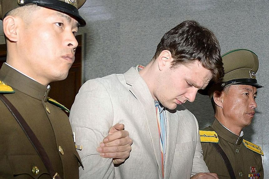 Warmbier, a University of Virginia student, being taken out of North Korea's top court after being sentenced. He was given 15 years hard labour for what Pyongyang called hostile acts against the country.
