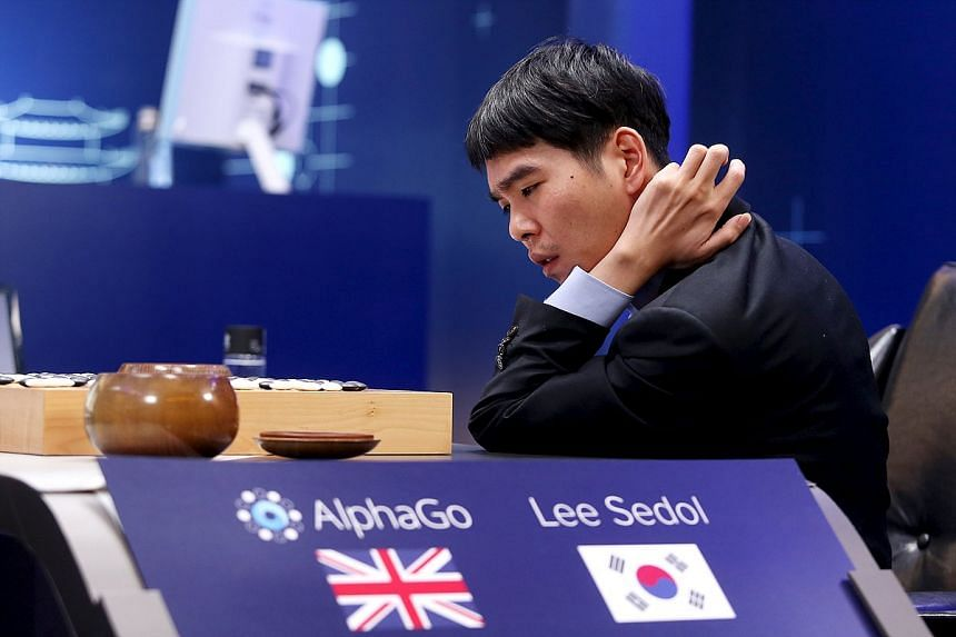 Top Go player Lee Sedol reviews the match against Google's artificial intelligence program AlphaGo, on March 13, 2016.
