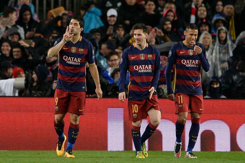 Barcelona's Luis Suarez (left) celebrates his goal with Lionel Messi (centre) and Neymar, on March 16, 2016.