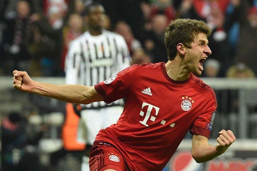 Bayern Munich's midfielder Thomas Mueller celebrates scoring the 2-2 goal.