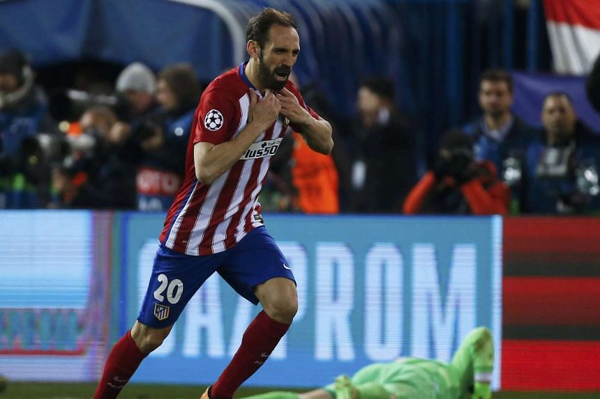 Atletico Madrid's JuanFran Torres celebrates after scoring the winning goal during a penalty shootout after extra time in their match.