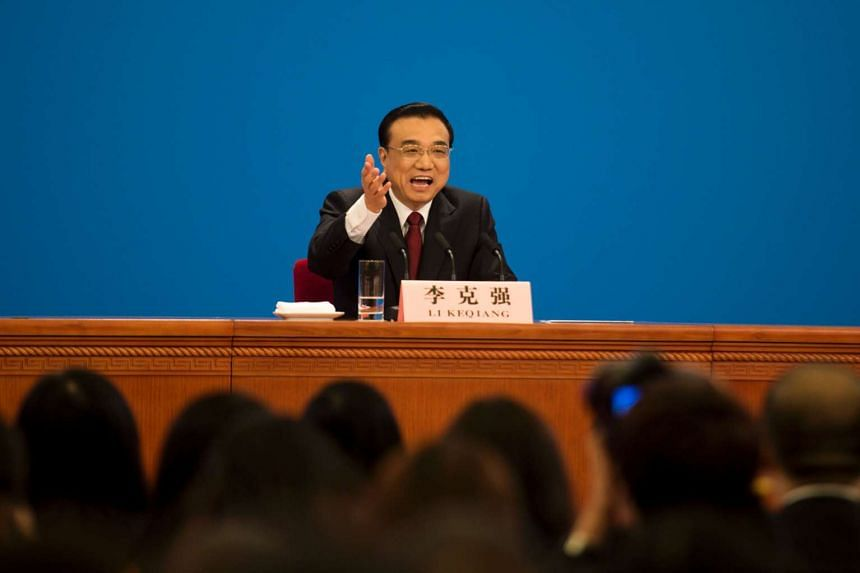 Chinese Premier Li Keqiang speaks at a press conference at the National People's Congress in Beijing, on March 16, 2016.