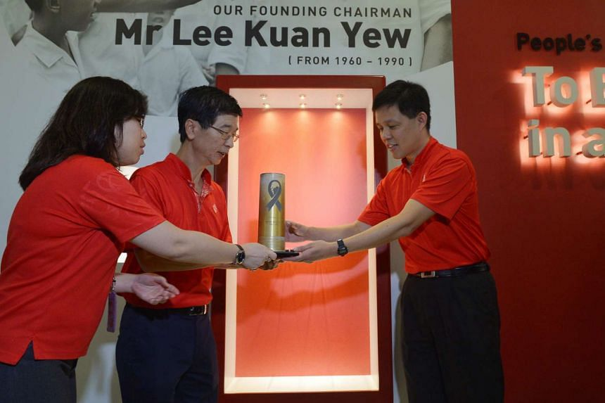 PA's deputy chairman Chan Chun Sing (right) and chief executive director Ang Hak Seng receiving the artillery shell casing.
