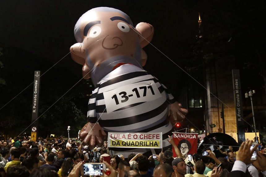 Demonstrators protest against the appointment of former President Luiz Inacio Lula da Silva as a minister, in Sao Paulo, on March 16, 2016.