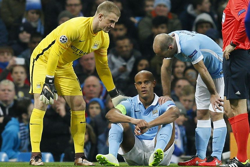Manchester City's Joe Hart (left) and Pablo Zabaleta console their skipper Vincent Kompany after the Belgian suffered another injury to his calf, ruling him out for at least a month.