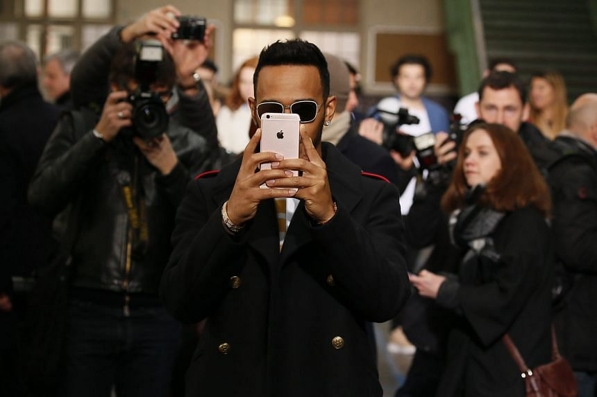 Mercedes driver Lewis Hamilton, seen here at Paris Fashion Week, has been courting controversy at an Auckland casino and later when he filmed himself riding a motorcycle on a highway. The defending world champion is keen to go into the Australian GP with