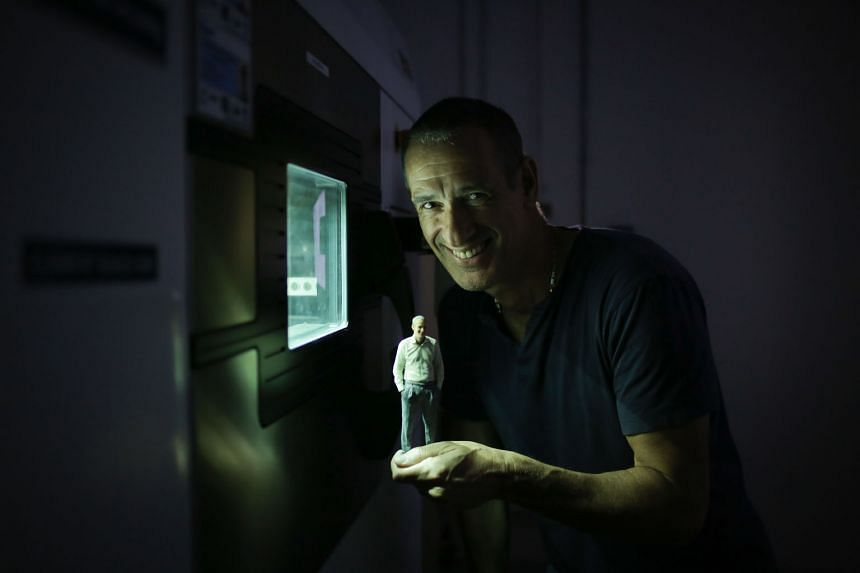 Mr Lev, UCT's senior vice-president for Asia, showing a 3D-printed figurine of himself. UCT runs the largest commercial 3D-printing facility in South-east Asia at a factory in Woodlands Spectrum. The 3D-printing, or additive manufacturing, sector is set t