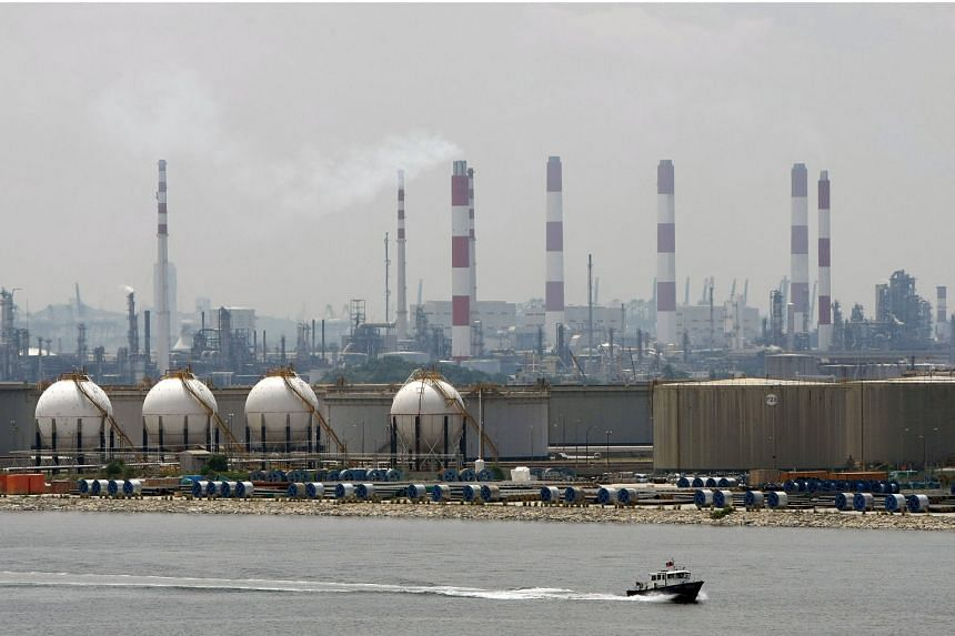 """Singapore's oil and gas sector has borrowed about $25 billion, with 74 per cent or $18.3 billion of that sourced from banks. Credit Suisse maintains an """"underweight"""" call on the offshore and marine sector, which is """"not (yet) out of the woods""""."""