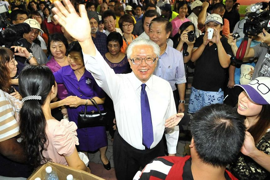 Dr Tony Tan waving to his supporters during the presidential election at Toa Payoh Stadium on Aug 27, 2011.
