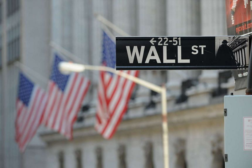 The Wall Street sign outside the New York Stock Exchange in New York.