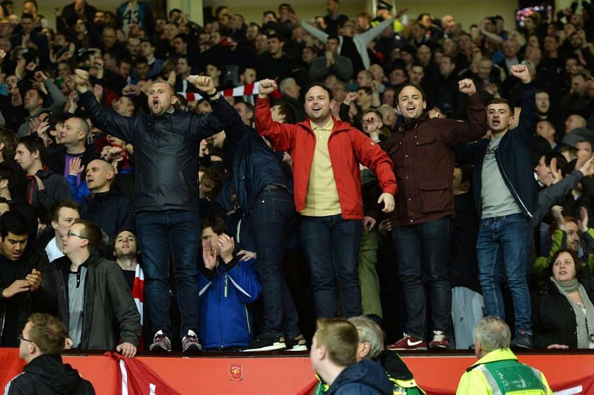 Liverpool fans celebrating during the Europa League clash against Manchester United at Old Trafford on March 17, 2016.