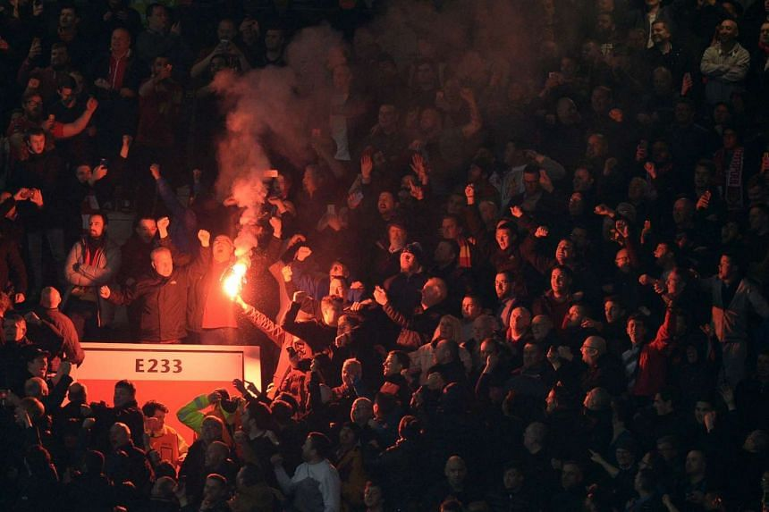 Flares were lit by the Liverpool supporters during the Uefa Europa League round of 16, second leg football match between Manchester United and Liverpool, on March 17, 2016.