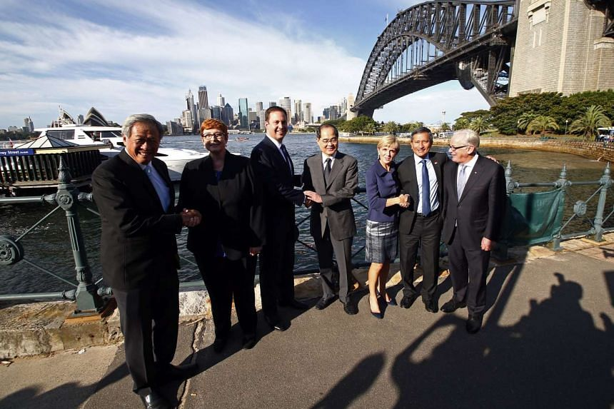 Singapore's ministers Ng Eng Hen (left),  Lim Hng Kiang (fourth from left) and Vivian Balakrishnan (second from right) with Australian officials including Foreign Minister Julie Bishop (third from right).