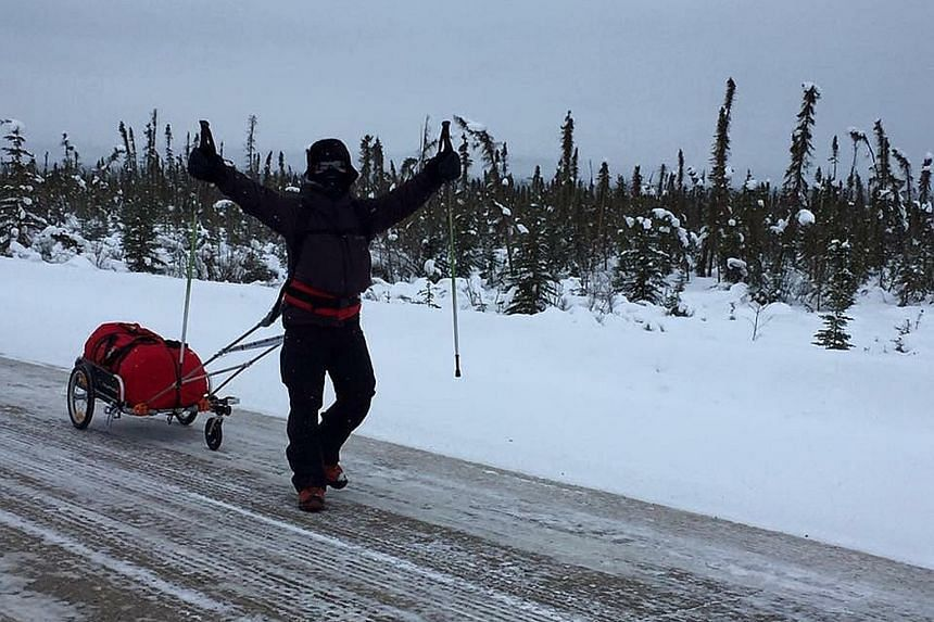 Still going strong after six days, Mr Toh hopes people will support The Straits Times School Pocket Money Fund. Mr Toh Poh Joo with his provisions cart, which he is hauling across Canada in a 566km trek while struggling with temperatures as low as mi