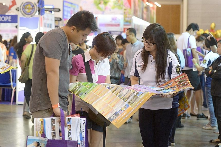 Visitors at a National Association of Travel Agents Singapore travel fair. With more people going overseas and greater awareness of the need for coverage, the travel insurance segment has seen rapid growth, says the General Insurance Association.