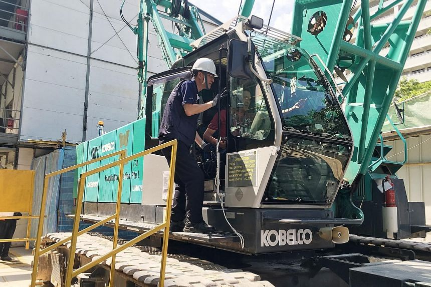 Mr Tan inspected machinery operations and safety features during his visit to the Coco Palms condo construction site yesterday.