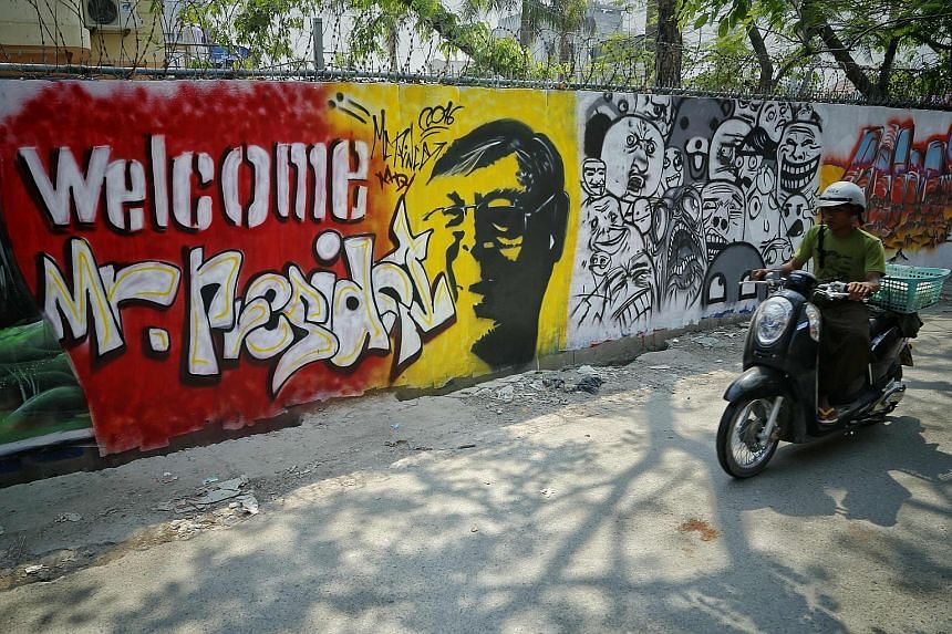 A wall with graffiti welcoming Myanmar's President-elect Htin Kyaw in Mandalay. A new civilian leadership, led by Ms Aung San Suu Kyi and Mr Htin Kyaw, will take office at the end of the month.