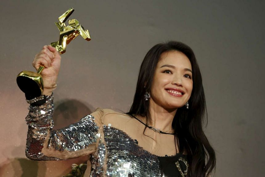 Taiwanese actress Shu Qi poses with her Best Actress award for The Assassin.