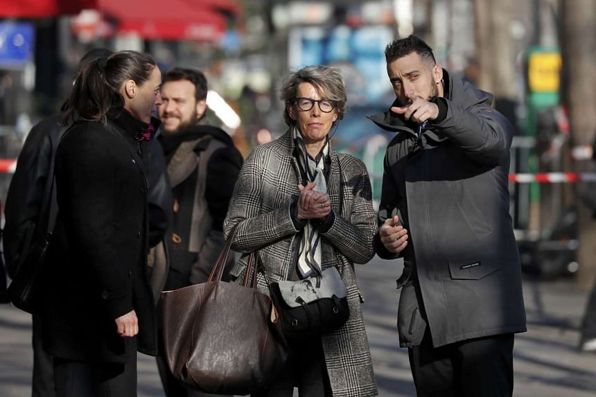 Nadine Ribet-Reinhart (centre), whose son was killed, stands in front of the Bataclan concert hall on March 17, 2016.