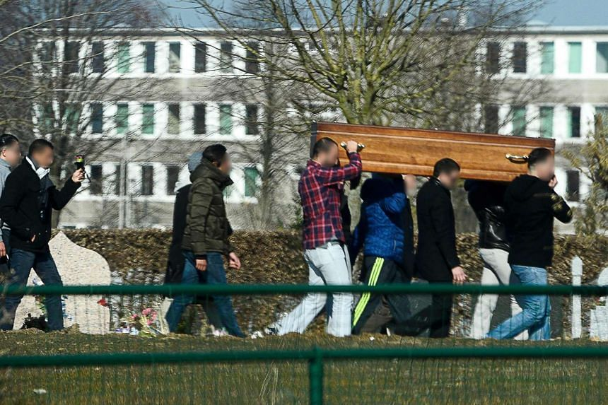Relatives and friends carry the coffin of Brahim Abdeslam.
