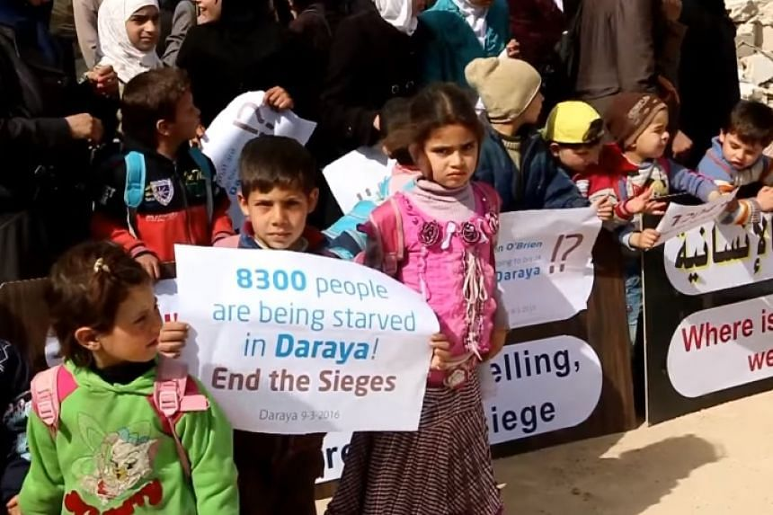 A screenshot from a video posted to YouTube on March 9, 2016, calling for help for Daraya.