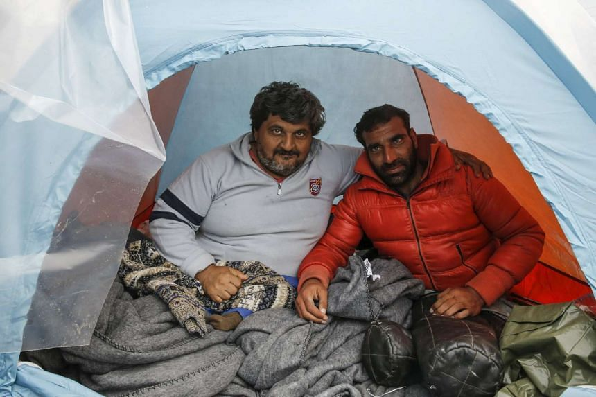 Mr Omar (left) and Mr Radwan Sheikho, 30, inside their tent at a makeshift camp near the village of Idomeni, Greece, on March 17.
