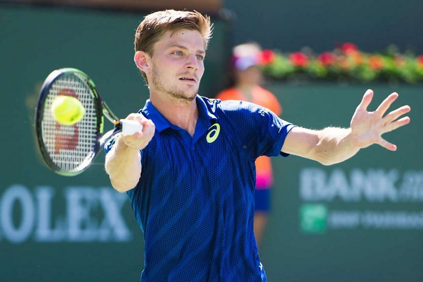 David Goffin of Belgium returns a shot to Marin Cilic of Croatia, on March 17, 2016.