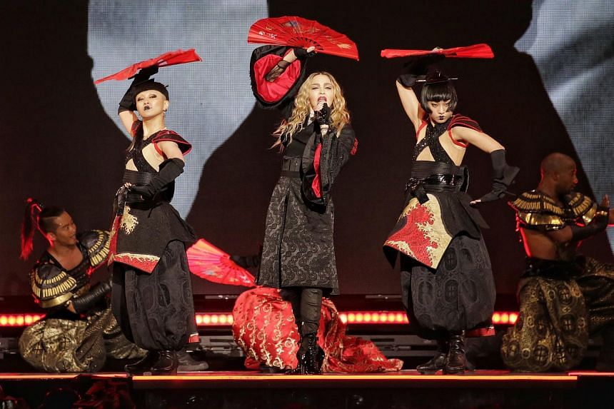 Singer Madonna exposed a fan's breast on stage Thursday (March 17) during her concert in Brisbane, Australia.