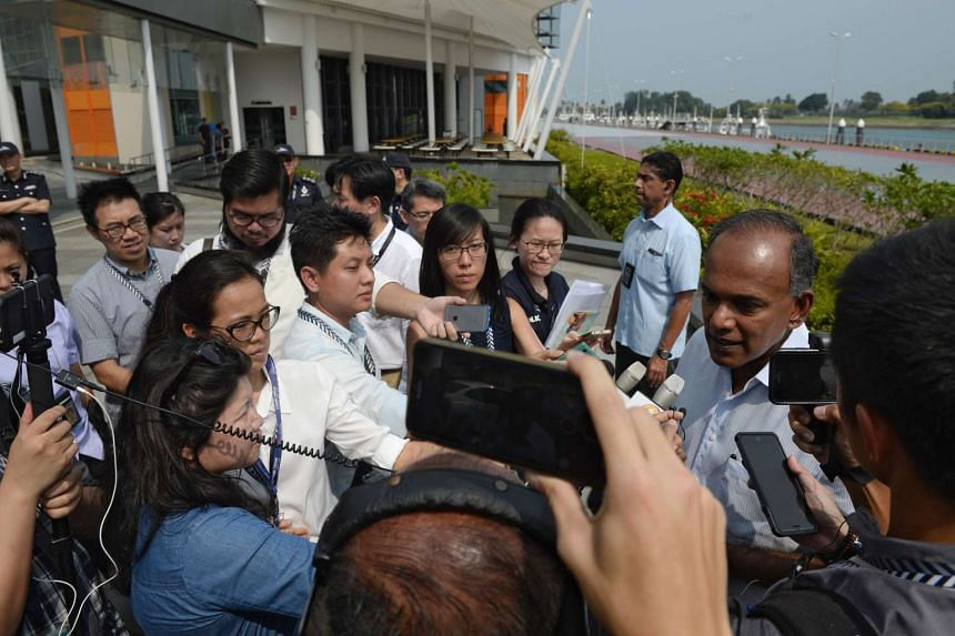 Minister K Shanmugam (right), speaks to the media during a showcase of the Police Coast Guard's showcase of their counter-terrorism and maritime security measures, at PCG Brani Base on March 18, 2016.