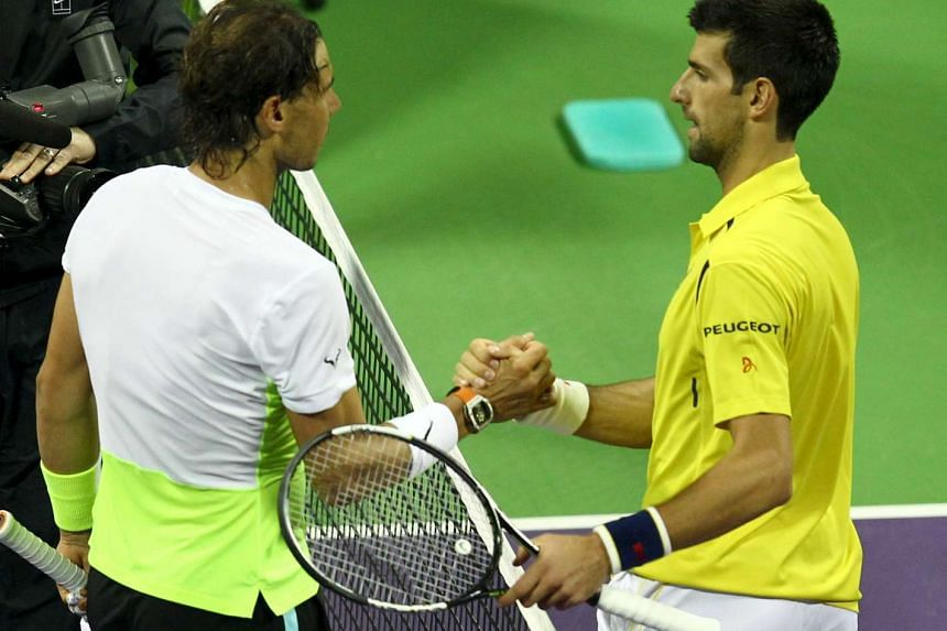 Novak Djokovic of Serbia (right) shakes hands with Rafael Nadal of Spain during the Qatar Open, on Jan 9, 2016.