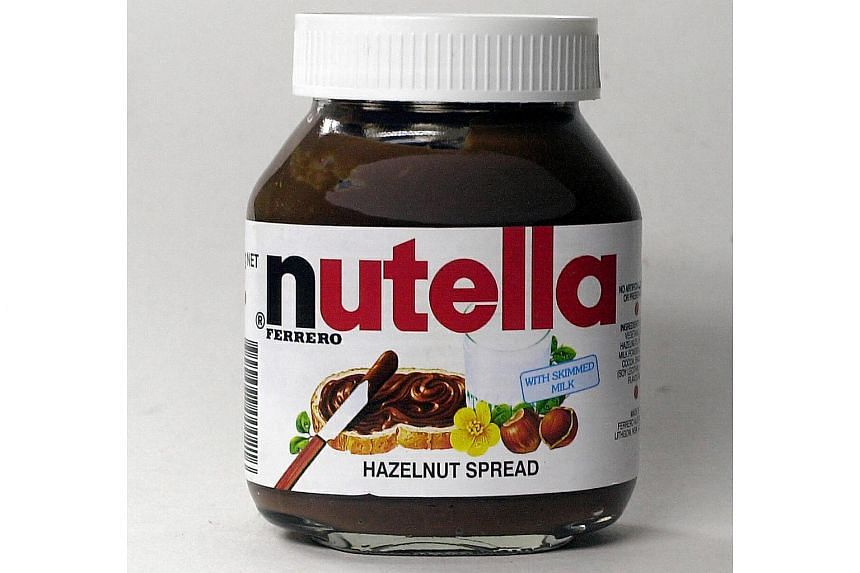 French lawmakers have voted to slash a surtax on imported palm oil - dubbed the Nutella tax - after protests from Indonesia and Malaysia.