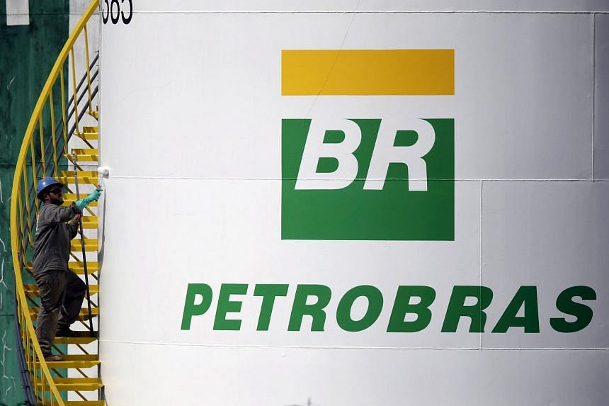 A worker paints a tank of Brazil's state-run Petrobras oil company in this Sept 30, 2015 file photo.