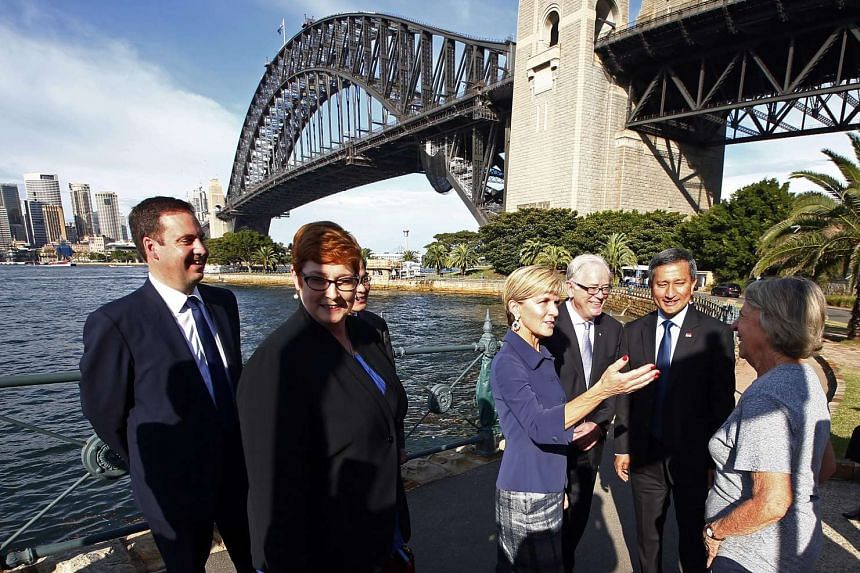 Singapore and Australia's ministers at Sydney Harbour on March 18, 2016.