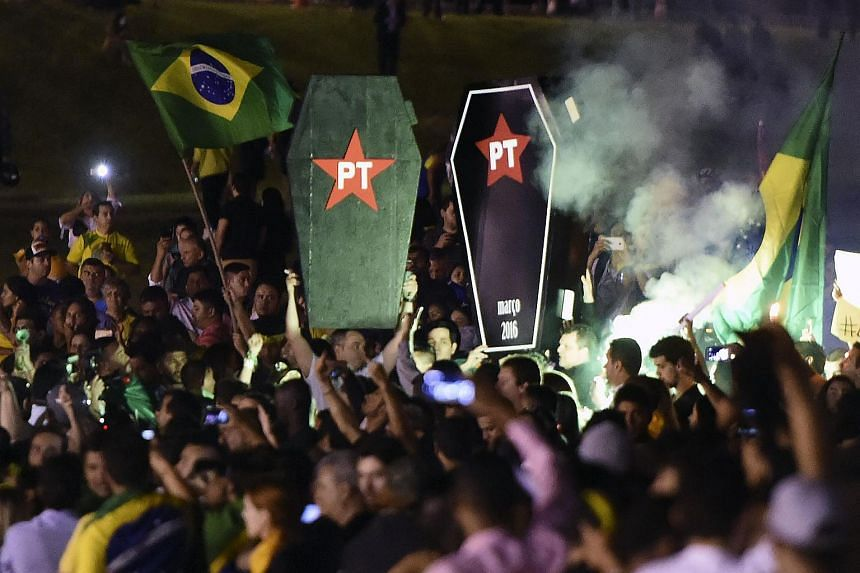 Activists in front of the Congress in Brasilia on March 17.