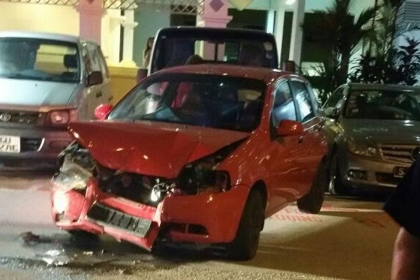 A taxi drove into a red car parked in front of it, which then crashed into a lorry at a Bedok carpark on March 17, 2016.