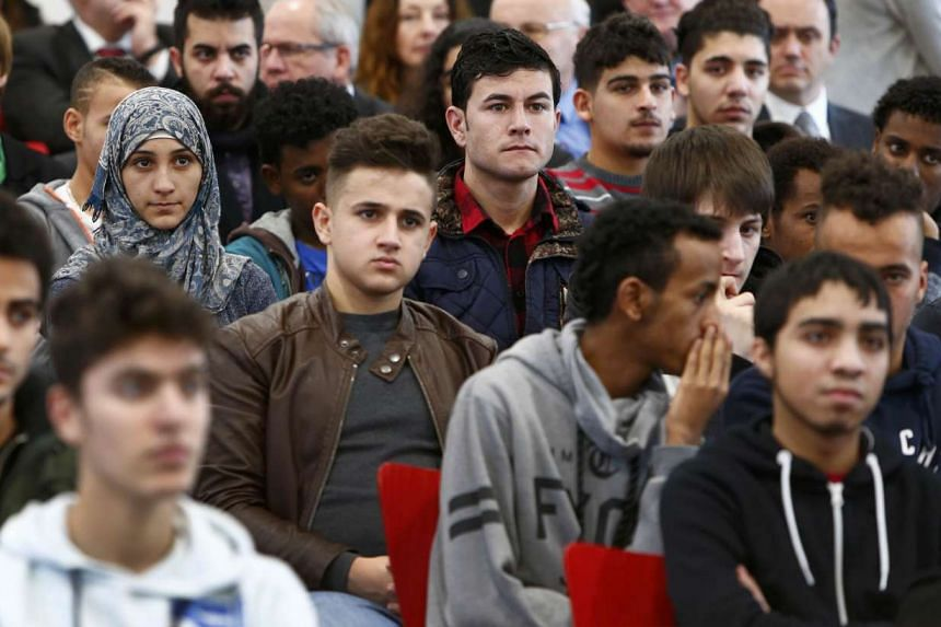 Young migrants from various countries attend a lesson on the basics of German law in January 2016.
