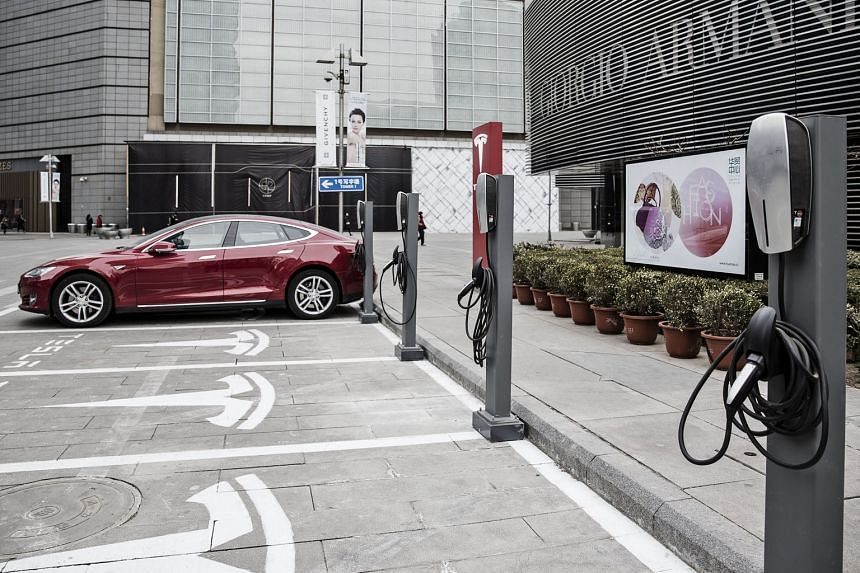 A Model S car parked at one of Tesla's charging stations in Beijing. In India and China, where power generation is heavily coal-based, electric vehicles have similar emissions as vehicles that use petrol.