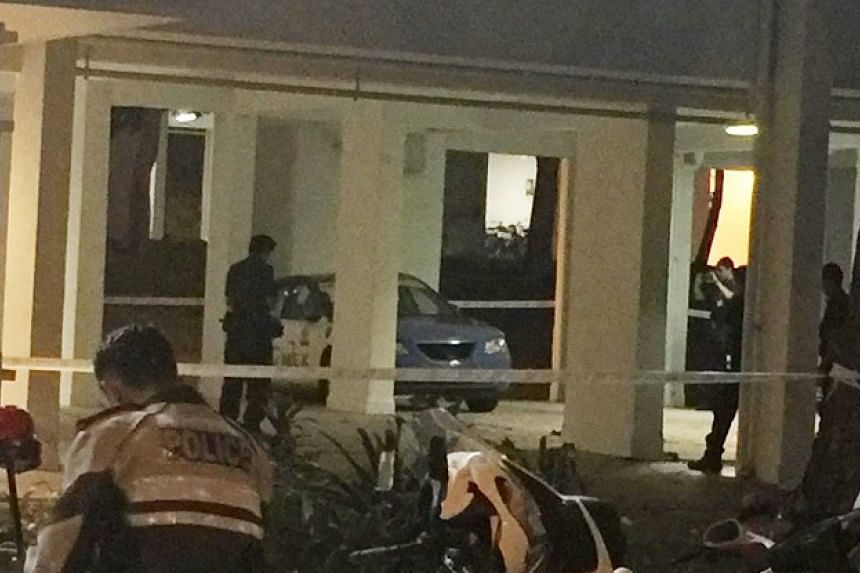 A taxi drove into a void deck in Bedok after damaging three vehicles at a carpark on March 17, 2016.