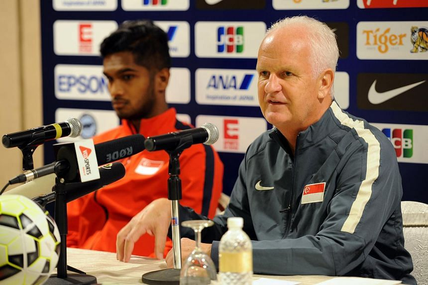 Bernd Stange, with skipper Hariss Harun (left), speaking at a press conference, on Nov 16, 2015.