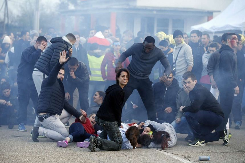 Police officers, military personnel and rescue helpers attend an exercise simulating a chemical attack by terrorists in an UEFA EURO 2016 soccer championship's fan zone, performed at the national police school in Nimes, southern France, on March 17,