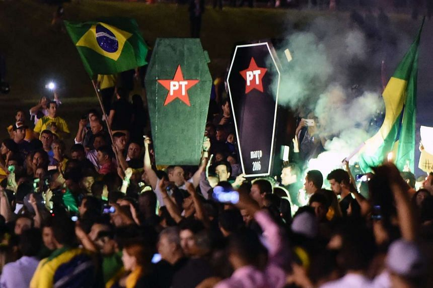 Activists protest in Brasilia on March 17, 2016. Brazilian lawmakers relaunched impeachment proceedings against President Dilma Rousseff on March 17 and a judge blocked her bid to bring her powerful predecessor into her cabinet, intensifying the poli